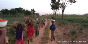 Girl Child returning from farm in Hara community