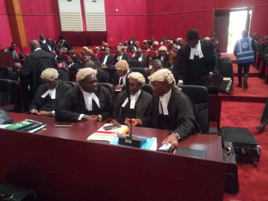 Wole Olanikpekun and Alex Izinyon (SANs) discussing at the tribunal