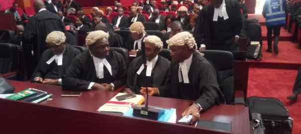 Wole Olanikpekun and Alex Izinyon (SANs) discussing at the tribunal