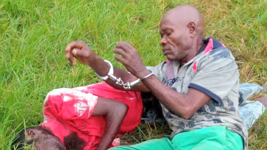 The alleged murderer Wilson and his victim, Okoro shortly after he was arrested at the Lagos State Polytechnic today