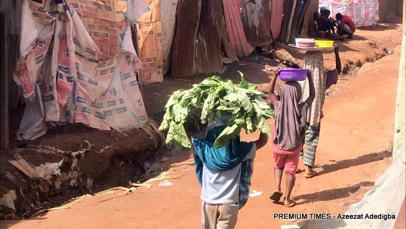 Marakisia, Amara and Sadia hawking their wares in Hausawa Village.