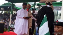 Yemi Osinbajo with his wife as he recites the oath of office.