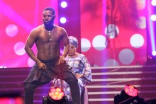 Falz performing a stripe tease on Sola Sobowale