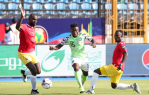Moses Simon of Super Eagles of Nigeria challenged by Ernest Seka Boka (l) and Naby Deco Keita of Guinea during the 2019 Africa Cup of Nations match between Nigeria and Guinea at the Alexandria Stadium, Alexandria on the 26 June 2019 ©Muzi Ntombela/BackpagePix (Photo Source: CAF Online)