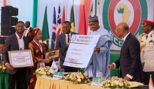 President Muhammadu Buhari presents 2018 Ecowas Excellence Awards of $20,000 to Wife of Late Former UN Secretary-General of the United Nation, Mrs. Kofi Annan as a mark of honour for a Distinguish Personality Category during the 55th Ordinary Session of the ECOWAS Authority of Heads of State and Government held at the State House Conference Center in Abuja. PHOTO; SUNDAY AGHAEZE. JUNE 29 2019