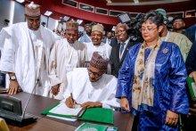 President Muhammadu Buhari signing the agreement establishing the African Continental Free Trade Area (AfCFTA), on behalf of Nigeria
