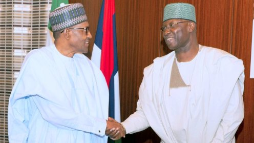 President Muhammadu Buhari in a handshake with the SGF Mr. Boss Mustapha during an audience with Founder of Dana Air the State House, Abuja. PHOTO; SUNDAY AGHAEZE. JULY 3 2019.