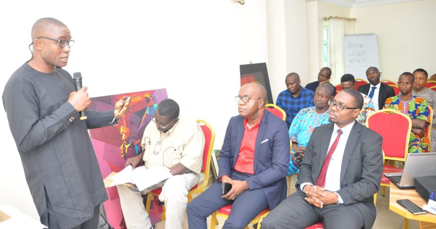 Head, Edo State Investment Promotion Office (ESIPO), Mr Kelvin Uwaibi (right), addressing stakeholders at the Okomu Smallholder Farm Development Project organised in collaboration with ESIPO and Terra Agriculture, in Benin City, Edo State.