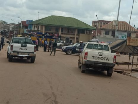 Police officers at the Abakpa main market where traders  clashed with revenue officials over Internally Generated Revenue (IGR) which allegedly led to the death of one person