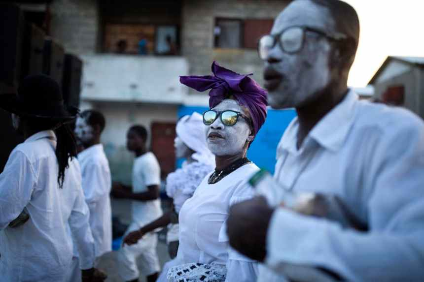 Voodoo believers walk during the annual Voodoo festival Fete Gede at Cite Soleil Cemetery in Port-au-Prince, Haiti. AP Photo/Dieu Nalio Chery