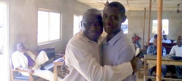 L-R: Mr Dele Ayeni, the passenger who forgot the money in an airport cab and Mr Adeniyi Olayinka , the airport cab driver who returned the N.8million forgotten in his cab by the passenger, in a warm embrace on Wednesday July 31, 2019 . (NAN)