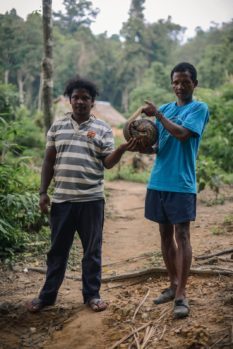 Two hunters from the indigenous Temiar community in Peninsular Malaysia pose with a pangolin they had just caught the day before. While researchers often find pangolins elusive and difficult to study, indigenous hunters' intimate knowledge of the forest and its animals allow them to track pangolins simply by recognising and following its tracks. The pangolin was later released. Credit: Puah Sze Ning / R.AGE
