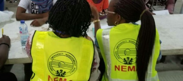Nigerians that returned from Libya being attended to by NEMA officials