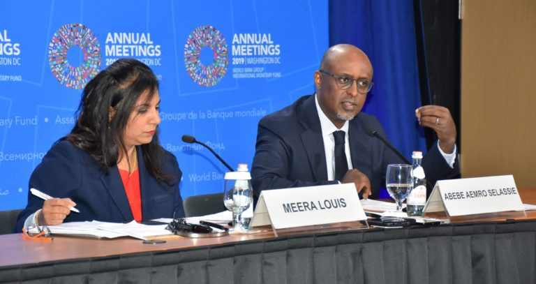 Mr Abebe Selassie, Director of the African Department at the IMF (right) with Ms Meera Louis, a Communications Officer at the Fund, during the media briefing. Photo: NAN