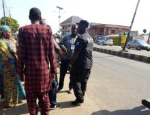 """An APC agent apprehended by SSS official after he was found with """"tickets"""" used for tagging voters for the collection of stipends after voting at the PU 008, Ward 01 in Lokoja. The tickets were seizes from him. He was not arrested."""