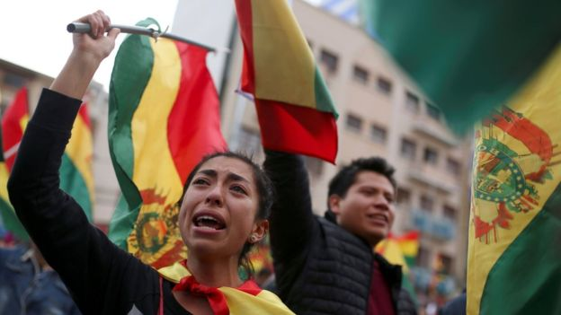 """Protesters chanted """"yes we could"""" and """"Bolivia"""" as they celebrated the resignation (Photo Credit: Reuters)"""