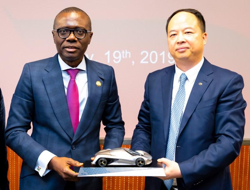 Babajide Sanwo-Olu (Left) receiving a gift from Yu Jun, Director International Business, Guangzhou Automobile Group (GAC Motors) at the company's headquarters in Guangzhou, China.