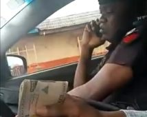 The police officer collecting bribe