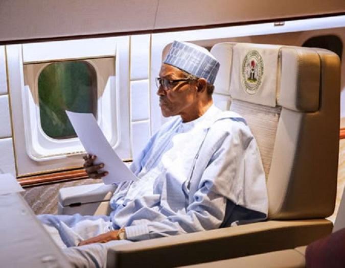 FILE PHOTO: President Muhammadu Buhari in a plane [Presidency]