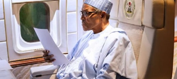 FILE PHOTO: President Muhammadu Buhari in a plane [Presidency]