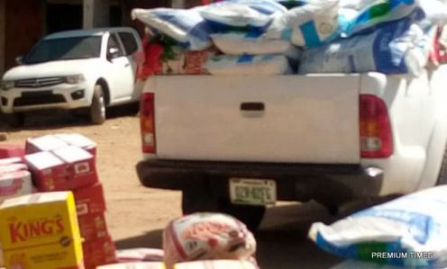 One of the officials monitoring the distribution of the food items counts what is left