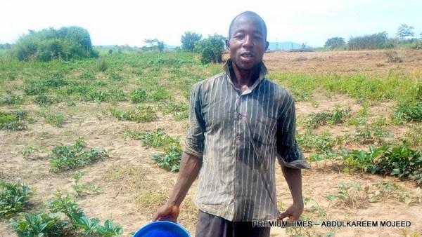 Danladi Iliyasu irrigating his vegetable farm at Sofo Toge.