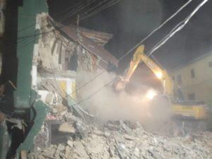 A LASEMA bulldozer demolishing buildings in Lagos