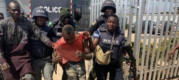 One of the suspects apprehended by the police [PHOTO: Twitter @BusinessDayNg]