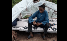 Tijani and Yusufa in their hovel on the cattle farm. Like other children, they spend nights there with cows