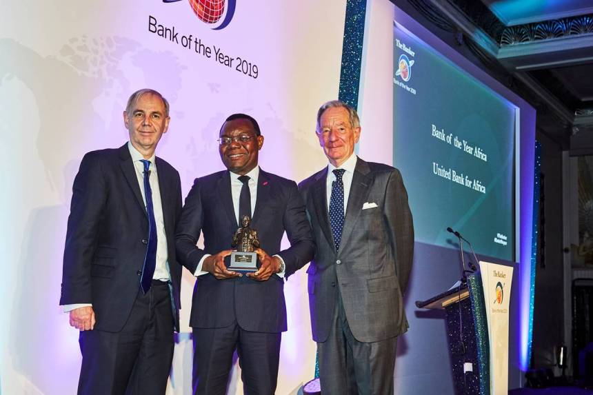 """CEO, UBA Africa, Mr Victor Osadolor(middle) with the """"African Bank of the Year 2019"""" won by United Bank for Africa (UBA) Group at The Bankers Awards held in London"""