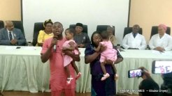 Conjoined twin babies, Goodness and Mercy Martins, with their parents after separation.