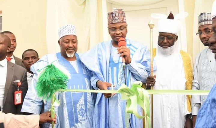 Minister of Communication and Digital Economy, Ali Pantami, middle, been assisted by governor Badaru and Emir of Hadejia Adamu Maje while commissioning community information technology centre in Hadejia Local Govt Area, Jigawa state, 20th Jan, 2020. (Photo: Jigawa new media office)