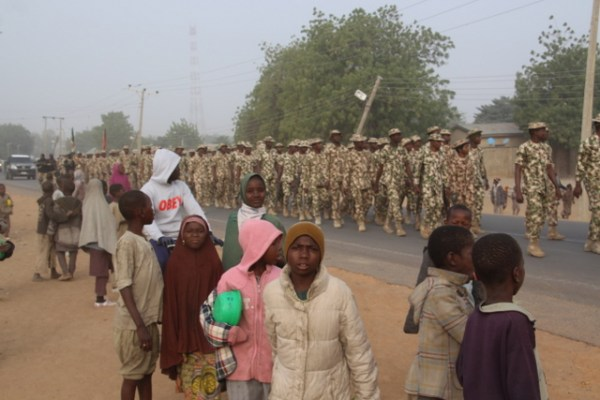 children marching with soldiers