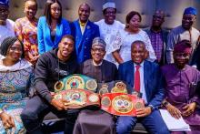 Anthony Joshua poses with President Buhari and Jeofrey Onyeama, Foreign Affairs Minister, in a picture.