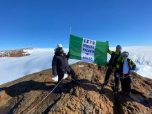 Ned Nwoko, Giles Harding and Captain Hamish Harding holding Nigeria's flag in Antarctica during the flag off of Prince Ned Nwoko Foundation's malaria eradication project in Africa.