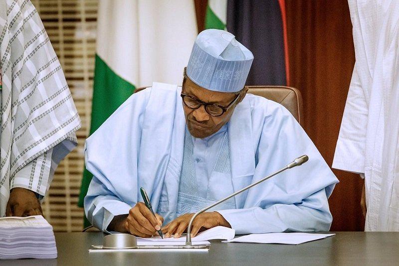 President Muhammadu Buhari signing