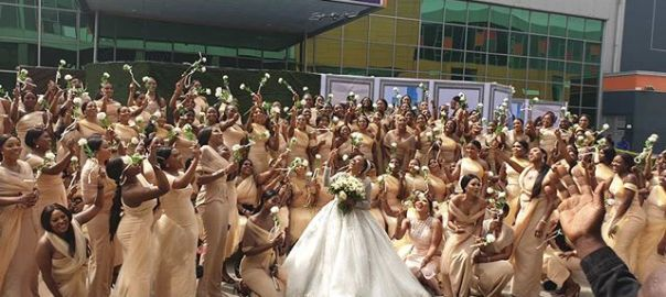 Sandra Ikeji and her 200 bridesmaids photo by Sandra Ikeji