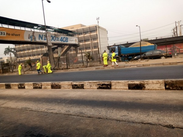 Street sweepers at Ojota carrying out their duties