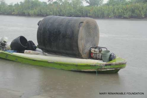 Water tank being ferried across the river to Edonwick community