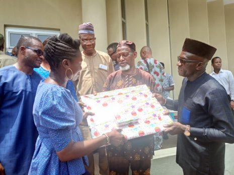 Celebrant Odia Ofeimun being presented gifts by some well-wishers