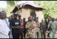 Dr. Goje(middle in black) with military comma ... th Hon. com sports at Dapchi this morning.jpg