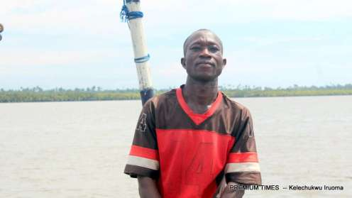 Sunday Kwesi sits on his canoe looking dejected