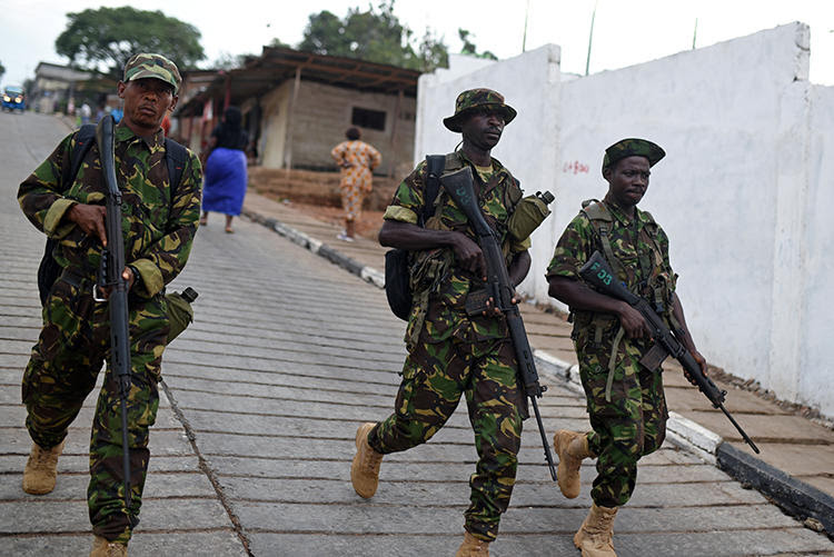 Soldiers are seen in Freetown, Sierra Leone, on March 31, 2018. Security forces recently assaulted and detained journalist Fayia Amara Fayia. (Reuters/Olivia Acland)