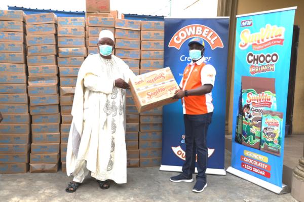 Marketing Manager, Promasidor Nigeria – Mr. Abiodun Ayodeji handing over the product donations to the Oba of Isolo - His Royal Majesty, Oba Kabiru Kolawole Alani Agbabiaka
