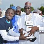 Governor Buni handing over working tools to one of the beneficiaries of his youth empowerment initiative