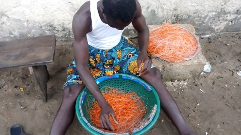 community chairman, Isiah Ikpo Williams, a fisherman making his fishing net but the lockdown has made life difficult to the extent his catch cannot be sold