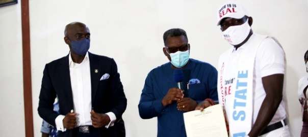 "Commissioner for Health, Dr. Ononye Mordi (middle); Secretary to State Government, Chiedu Ebie Esq. (left) and Chief Austin Eruotor, shortly after being decorated as ""Delta State Ambassador for the fight against COVID-19"" held in Government House Asaba. PIX: BRIPIN ENARUSAI"