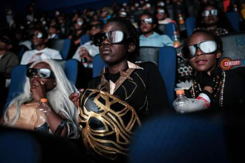 Audience members watch a screening of the film Black Panther in Nairobi, Kenya. YASUYOSHI CHIBA/AFP via Getty Images