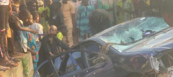 Car of bank staff hijacked and used to cart away loot from the bank.