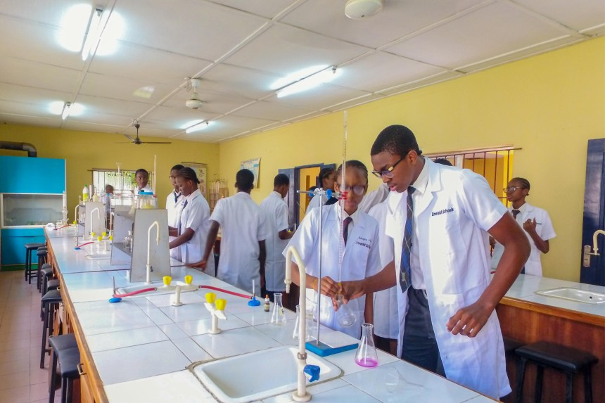 Senior Secondary school students in the Laboratory [PHOTO CREDIT: emeraldschools.com]
